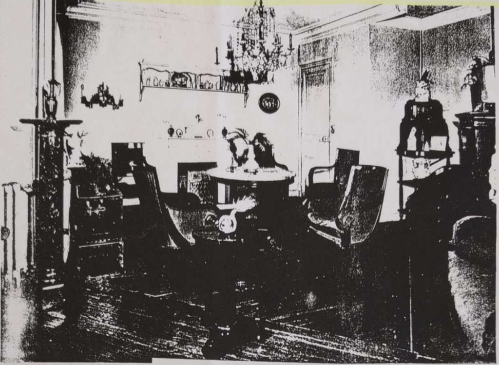 photo of a parlor with chandelier