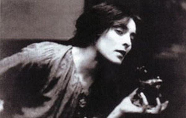photo of Mina Loy holding figurine c. 1903