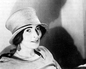 Mina Loy in top hat, c. 1917